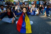 Students take part in a protest against Nicolas Maduro's government in Caracas